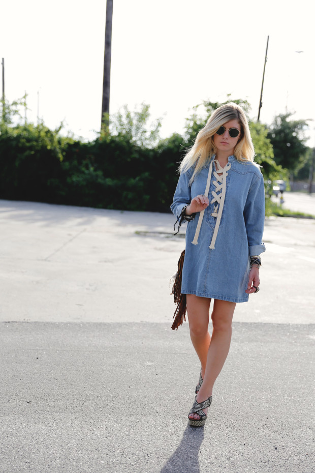 high end hippie denim lace up dress and round sunnies