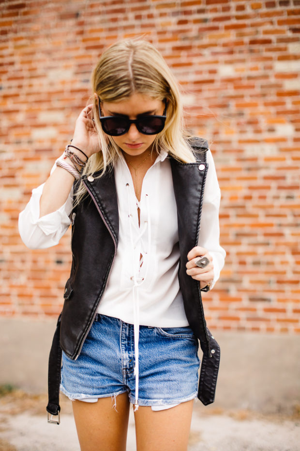 white lace up top and leather vest