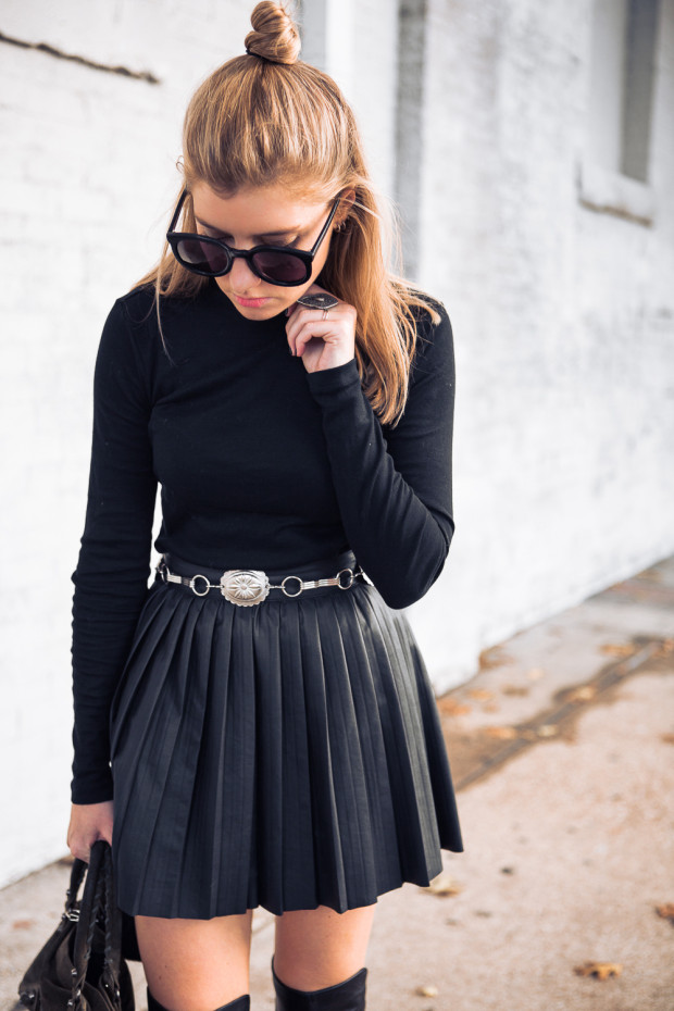 turlteneck and black leather mini skirt with pleats