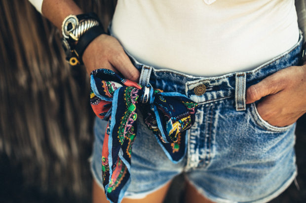 silk scarf tied on denim cutoffs